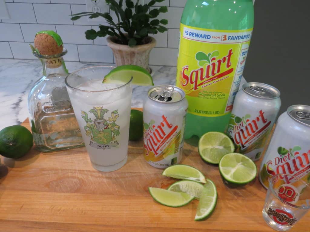 This is a view of the ingredients to make a Paloma; tequila, lime and squirt/diet squirt.