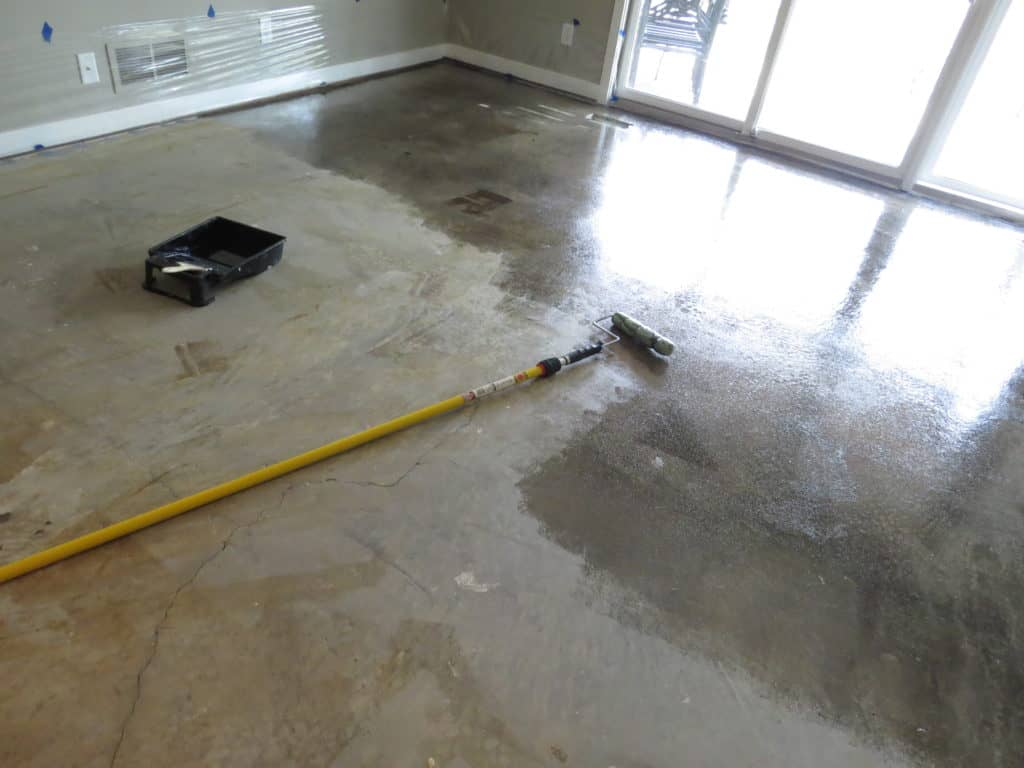 Almost halfway done staining the concrete floor.