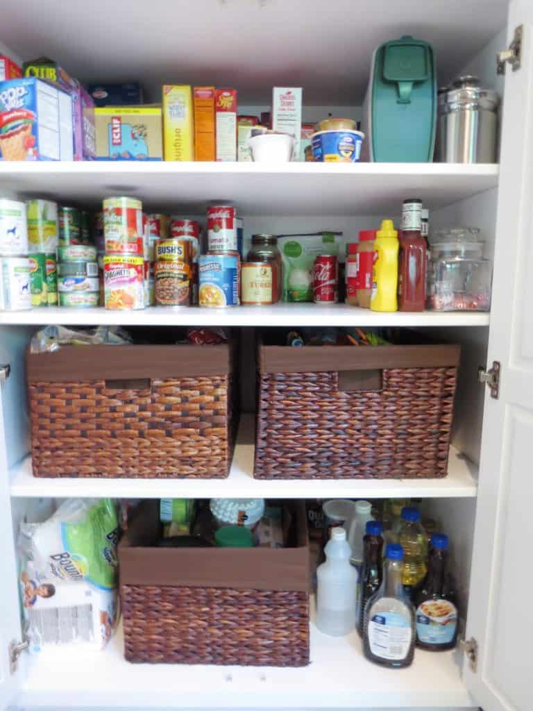 Pantry organization using baskets.