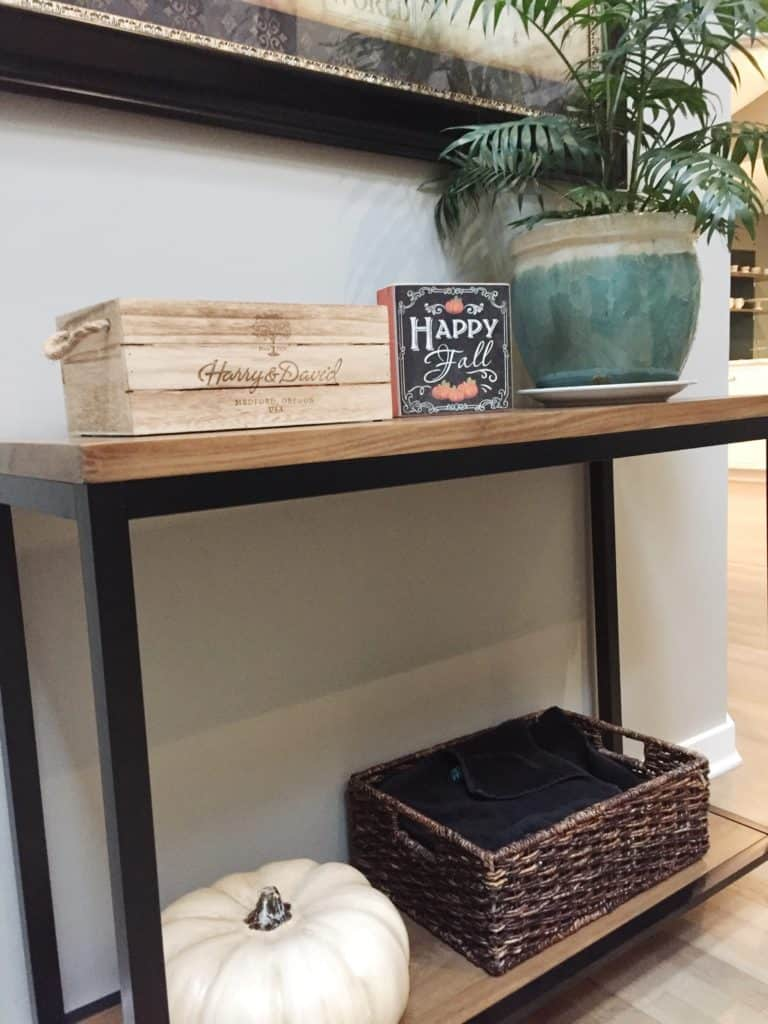 An example of decorating your entryway table for the Fall.