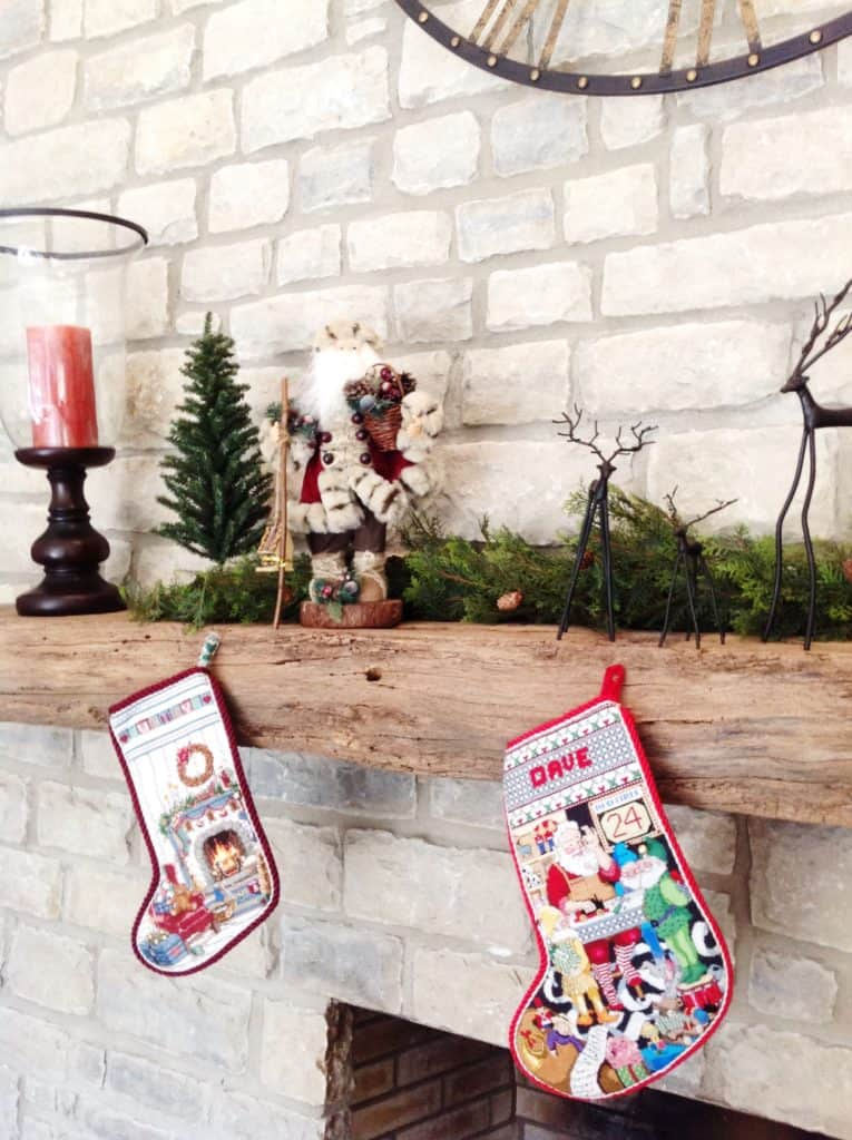 mantel decorations for christmas - rustic christmas mantel with santas, reindeer and homemade stockings