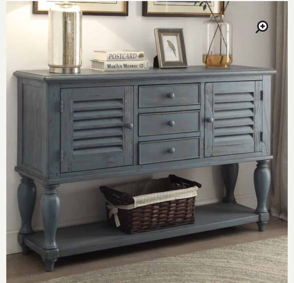 Moreno Console Table from wayfarer, it has a beautiful blue color with tons of storage in it.