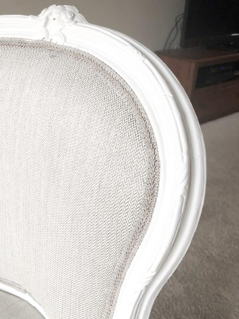 A closeup of the back of the reupholstered chair.