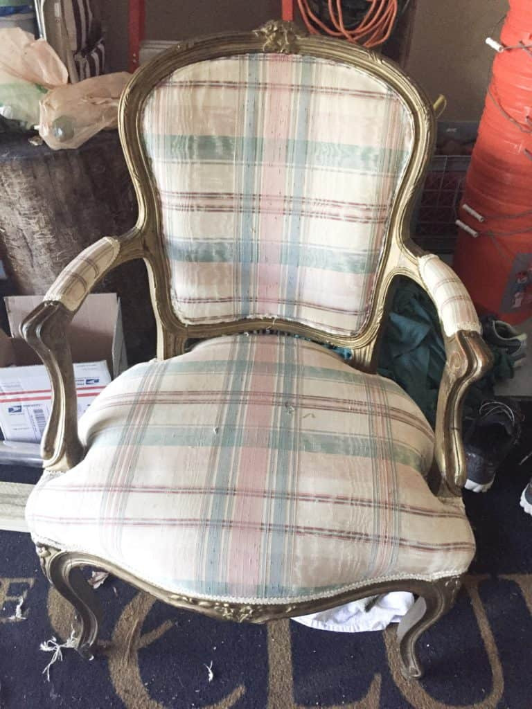 The French chair with gold paint and plaid fabric.