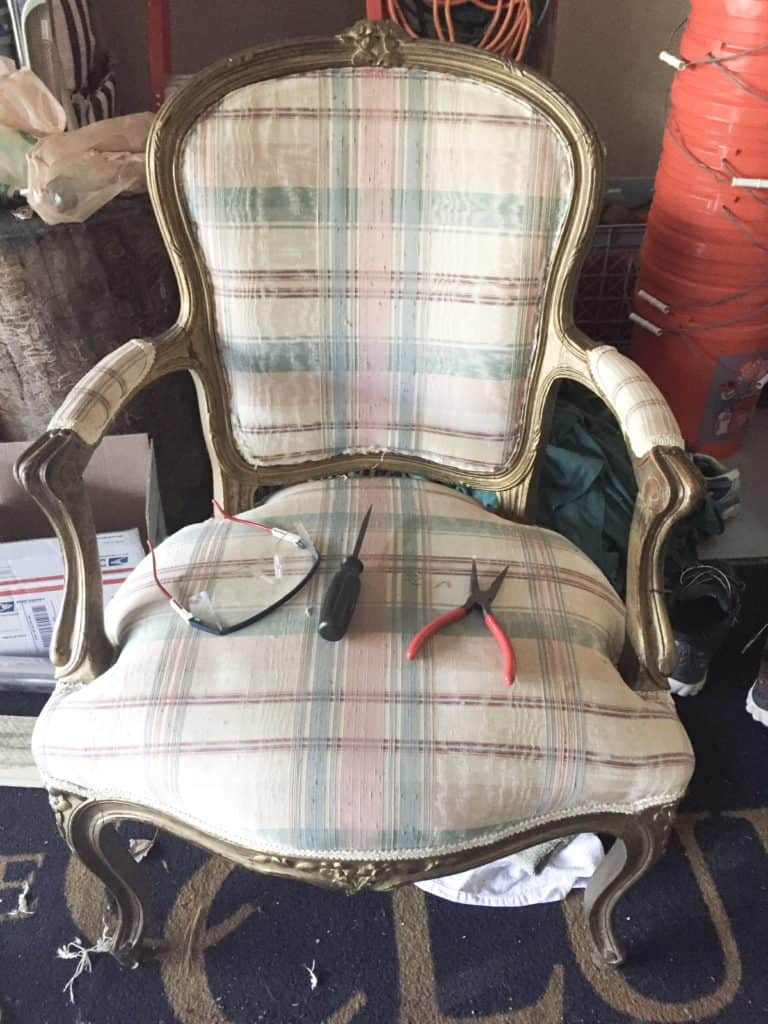 The French chair with gold paint and plaid fabric and the tools I used to rip the fabric off on the seat of the chair.