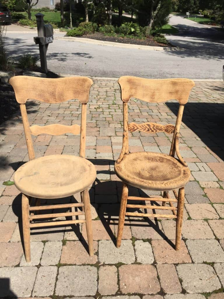 Both chairs after they have been sanded down to bare wood.