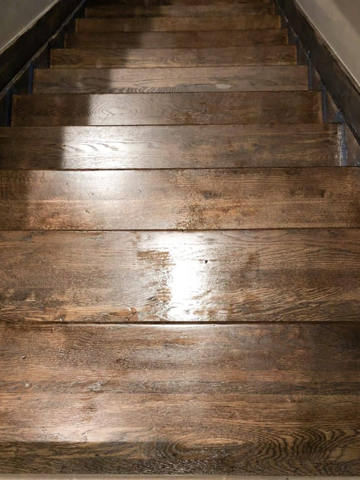 The next step was to choose stain and get started, that went really well. Then came the poly......and that took forever to dry!  But it's all done now and I can't wait to share my process on how to refinish stairs.