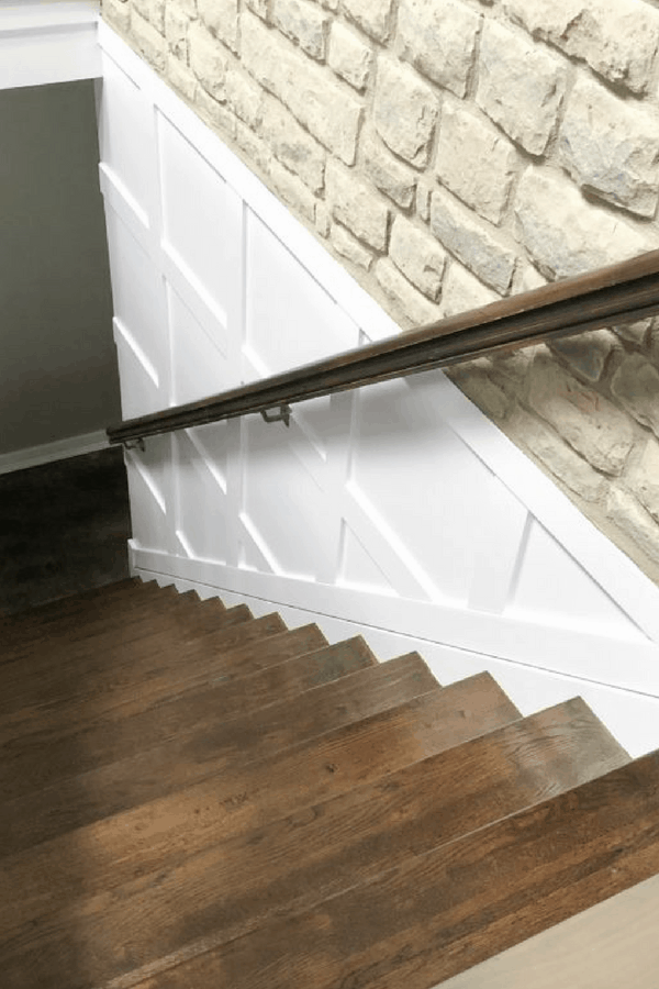 Board and Batten can be used to create a box shape on the wall to add interest and architectural detail. I love seeing this kind of detail in stairwells. I loved how the refinished stained stairs turned out but once I added the box molding and painted, that's when the magic happened!
