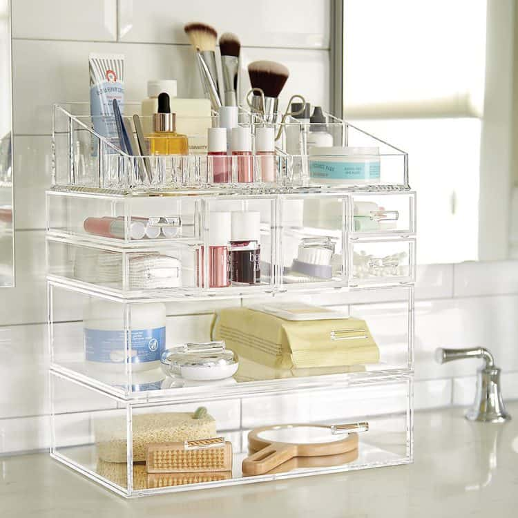 A clear storage container for makeup from the Container Store.