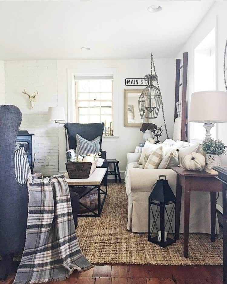 A family room with plaid blankets and pillows.
