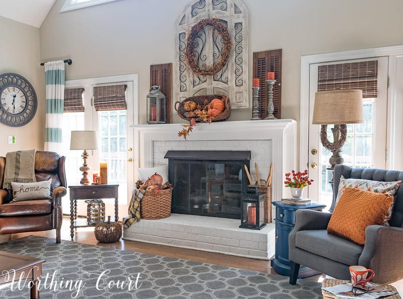 A family room that uses lots of orange fall decor.