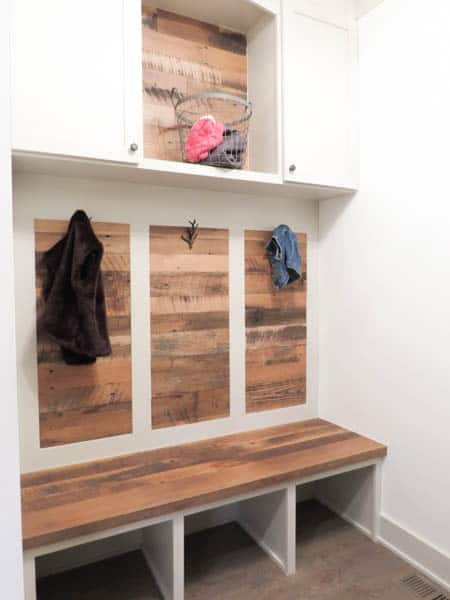This is a mudroom with a wood accent wall.