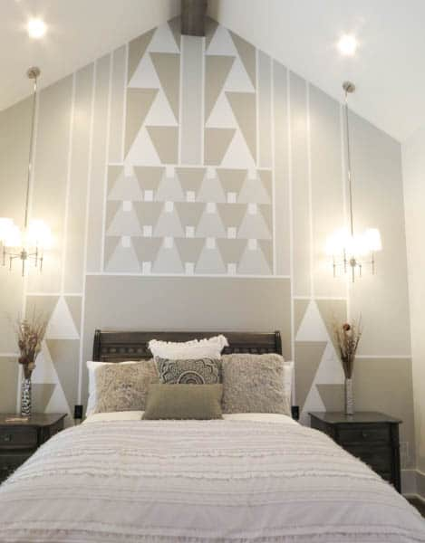 A headboard wall with geometric shapes painted on the headboard wall.