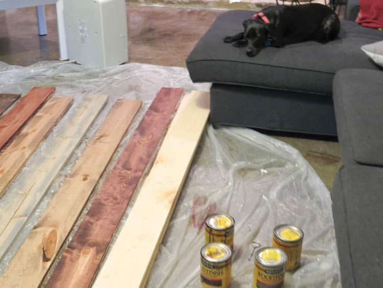 I laid the wood out on the floor over a drop cloth and stained the wood.