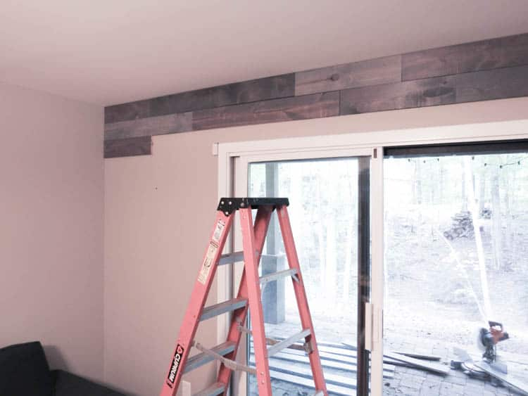 The wood installed for the top two rows on the wall.