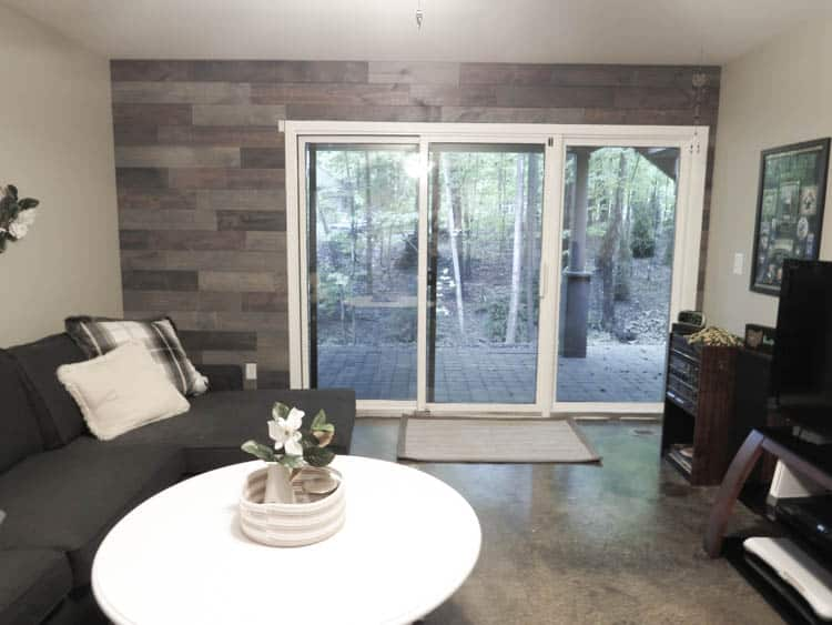 The view of the wood wall and the sliding glass door.