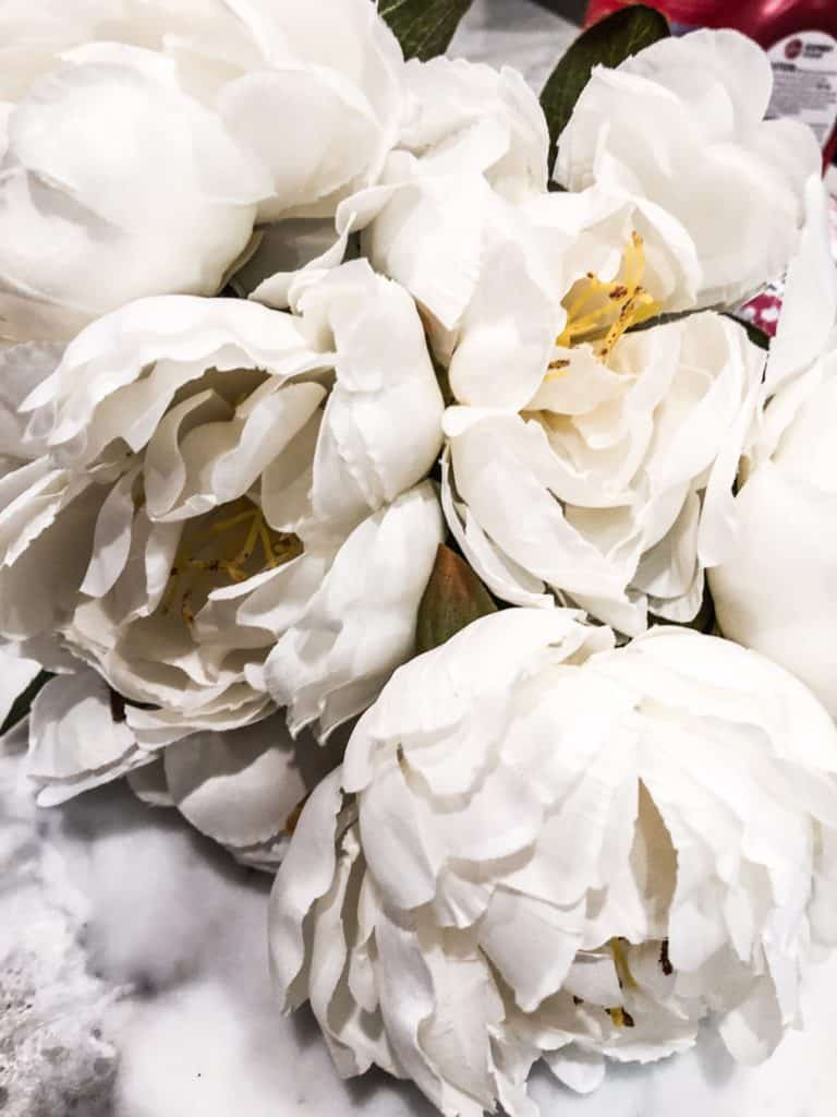 White peonies for a pumpkin floral arrangement.
