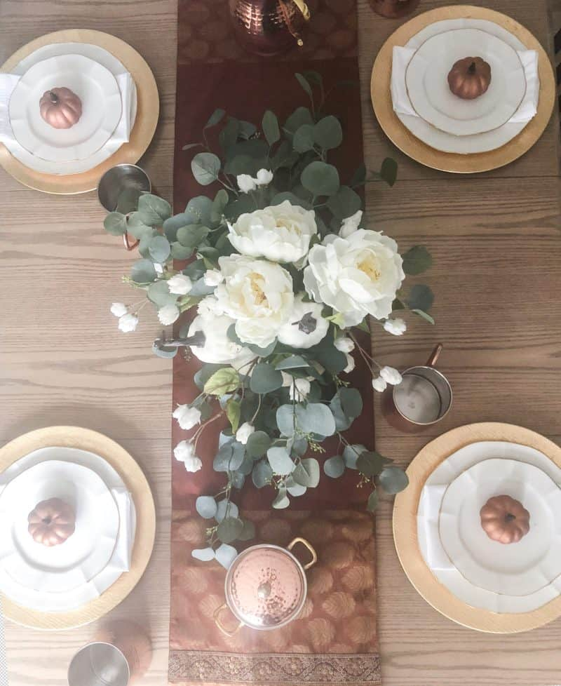 A birds eye view of the thanksgiving table setting.