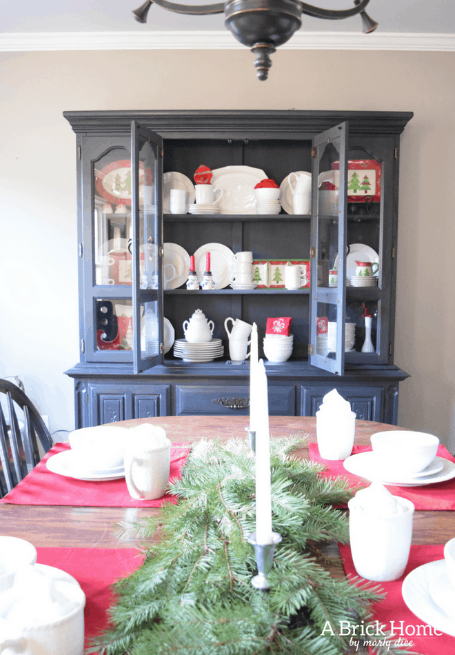 Farmhouse Christmas Dining Room. White and red theme
