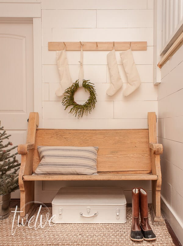 Farmhouse Christmas Decor, a Front entryway with a bench and lovely christmas decorations