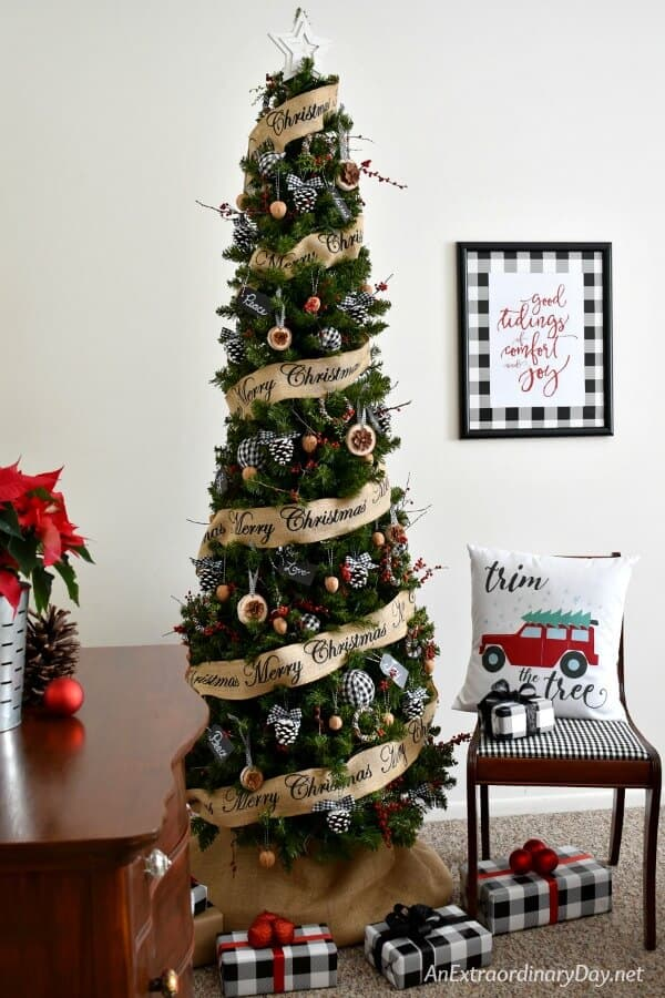 Farmhouse Christmas decor - here is a christmas tree with packages under and lots of buffalo check going on. Buffalo check christmas decor