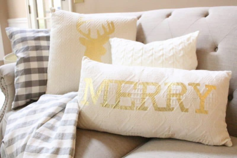 Farmhouse christmas Decor pillows one says merry and the other has a deer silhouette on it