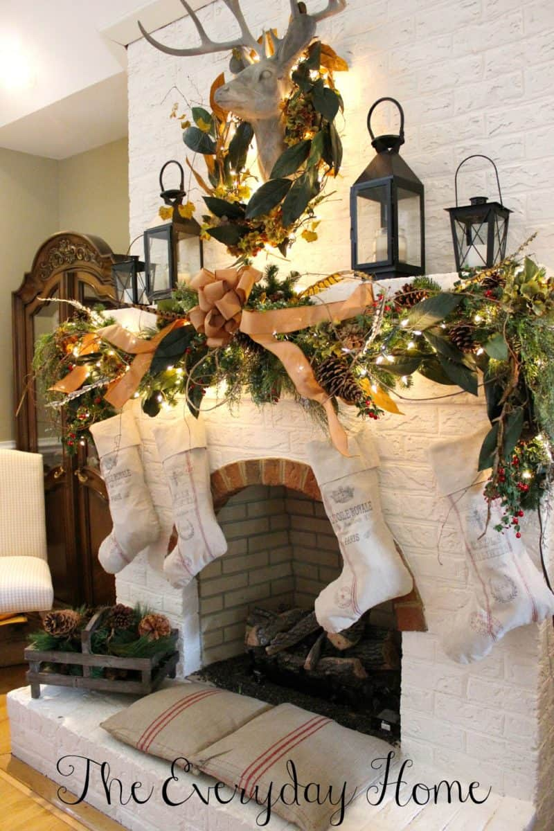 Mantel Decorations for Christmas, beautiful use of greenery in a wreath and garland and white stockings