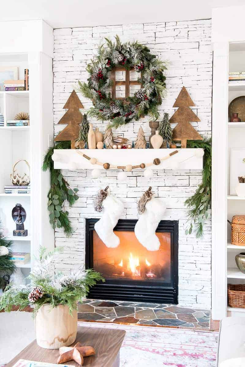 Mantel Decorations for Christmas, beautiful white stacked stone fireplace with lots of christmas greenery