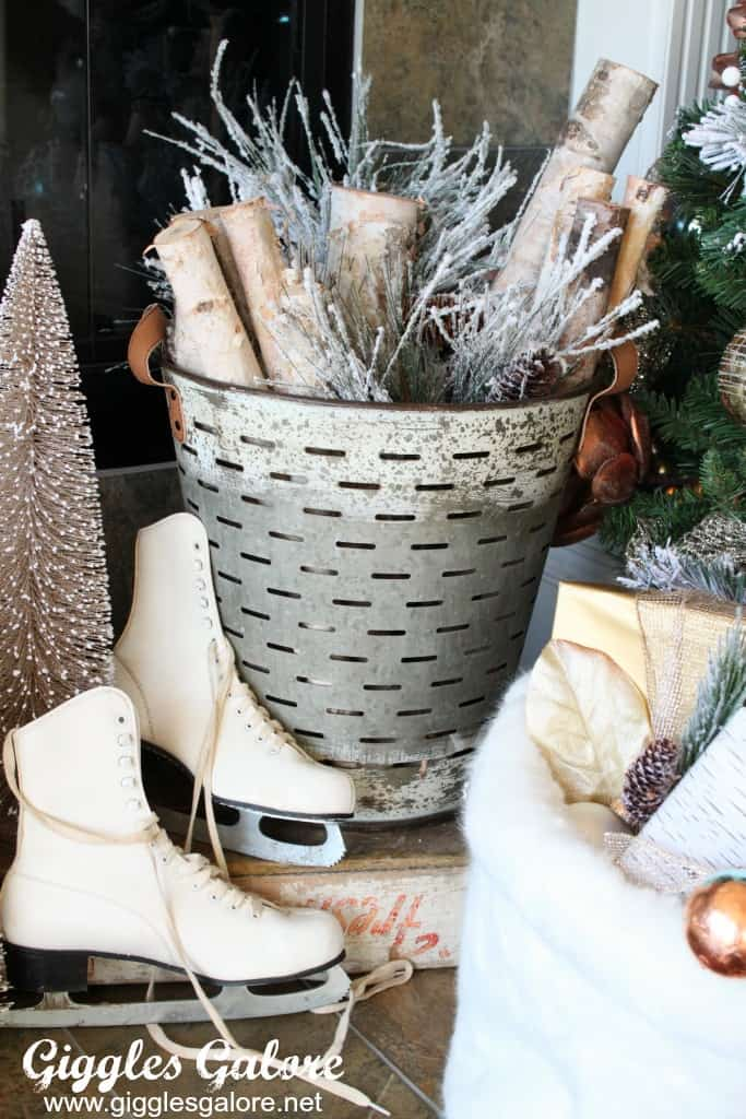 Farmhouse Christmas Decor Olive bucket with branches, skates by a fireplace