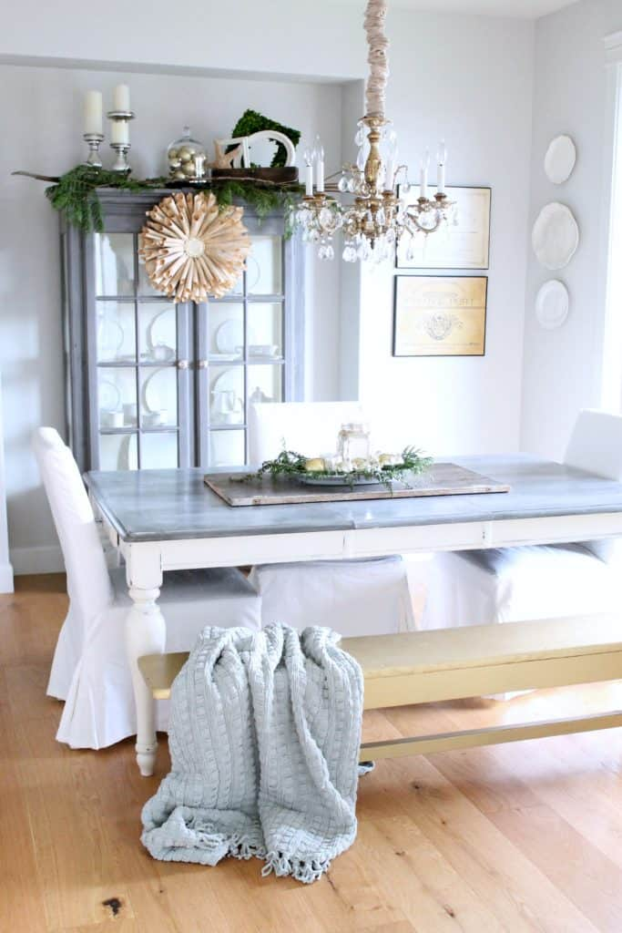Farmhouse Christmas Decor, a dining room with a beautiful table setting and wreath on a hutch
