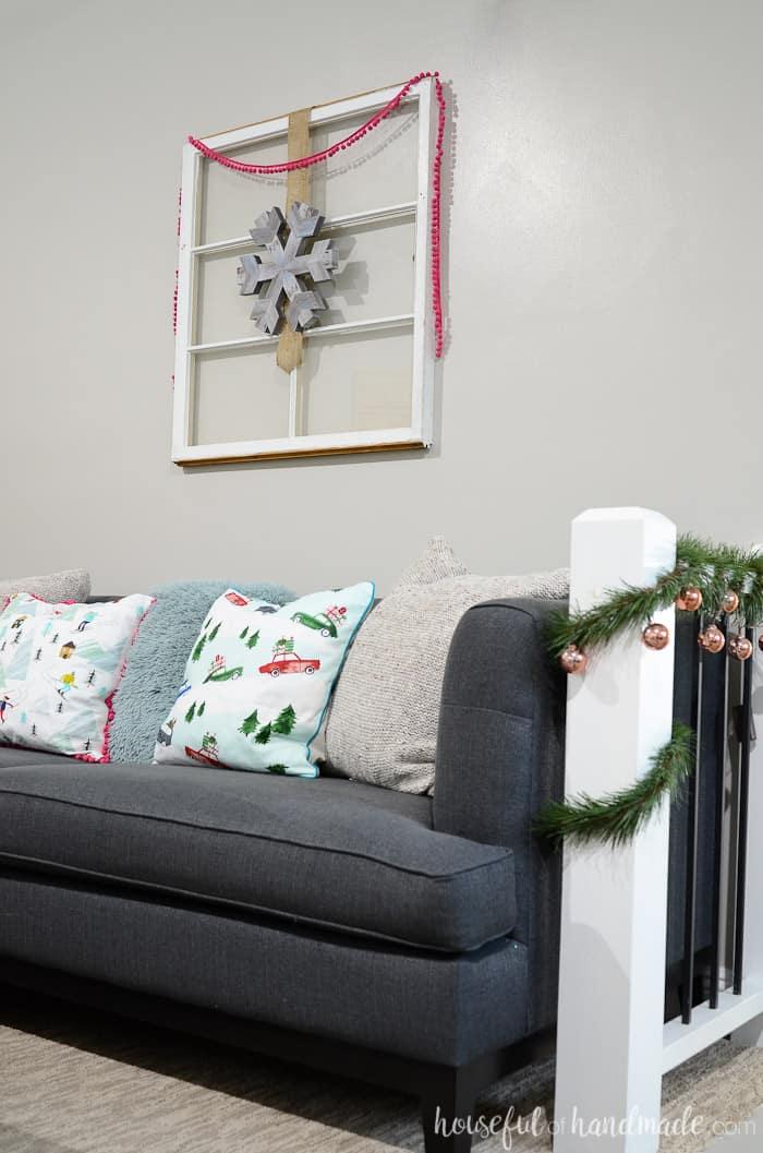 Farmhouse Christmas Decor simple garland, pillows and decor on a window frame
