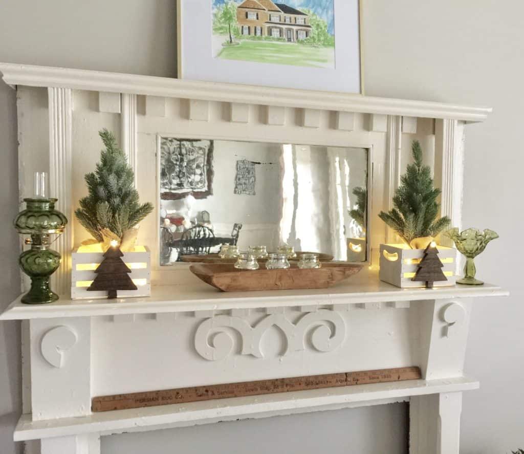 Farmhouse Christmas Decor a farmhouse mantel with table top christmas trees