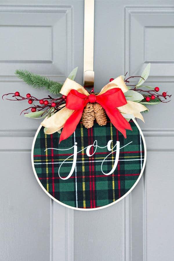 Farmhouse Christmas Decor, a hoop wreath with the word joy written on it