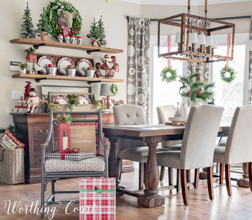 Farmhouse Christmas Decor, a dining room with lots of red and white decor, beautiful plats on display and mugs on a sideboard