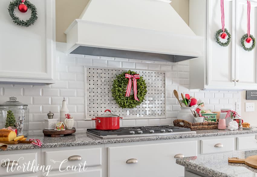 Farmhouse Christmas Decor, a kitchen with lots of red and white ribbon and green wreaths