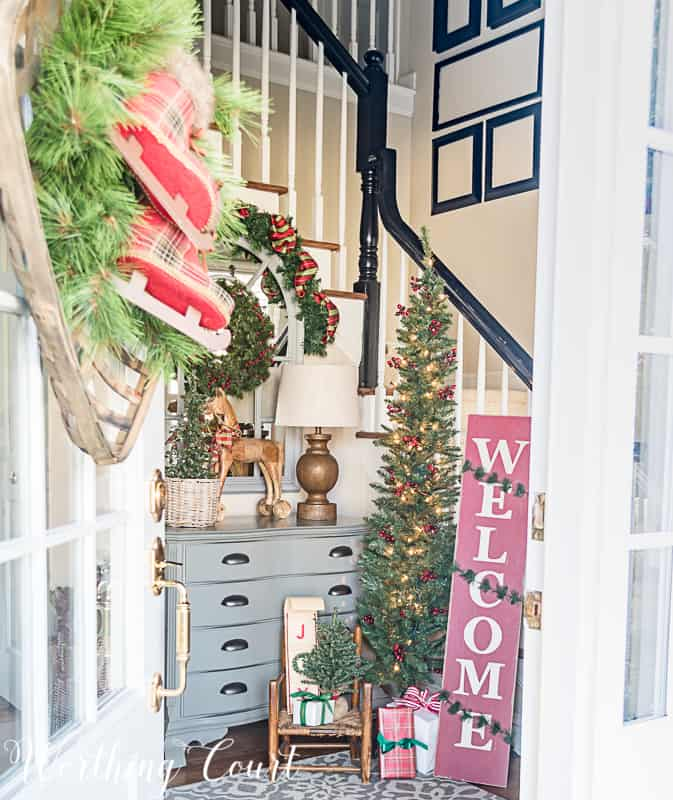 Farmhouse Christmas Decor, an entryway with a christmas tree, welcome sign and lots of wreaths and ribbon
