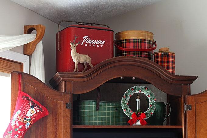 Vintage Christmas decor, plaid metal tins, a wreath and stocking