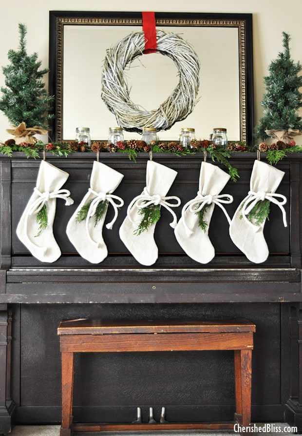 Mantel Decorations for Christmas - this isn't a mantel, it's an upright piano with stockings hanging from it. Great Idea if you don't have a mantel!