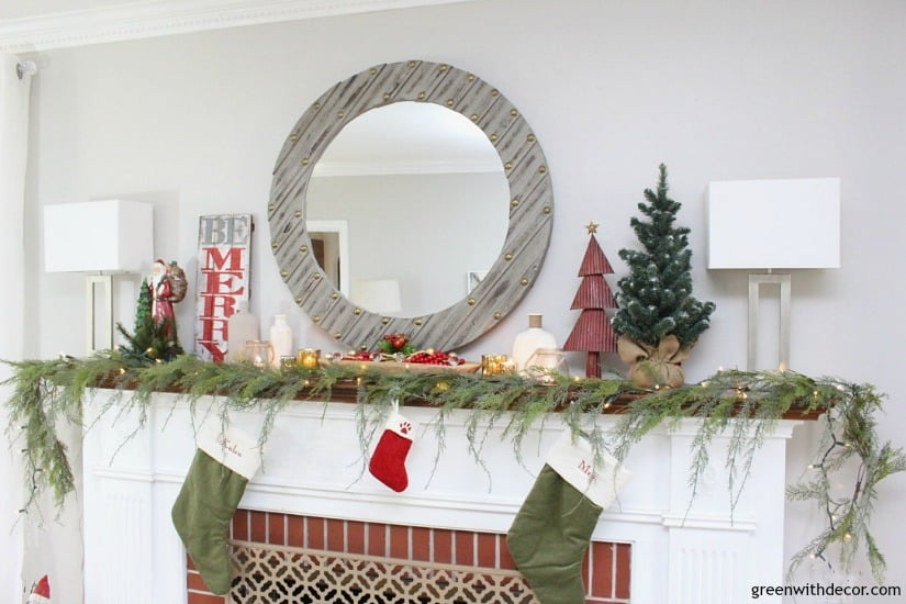 Mantel Decorations for Christmas - White mantel with garland that hangs off the mantel, traditional decor on top