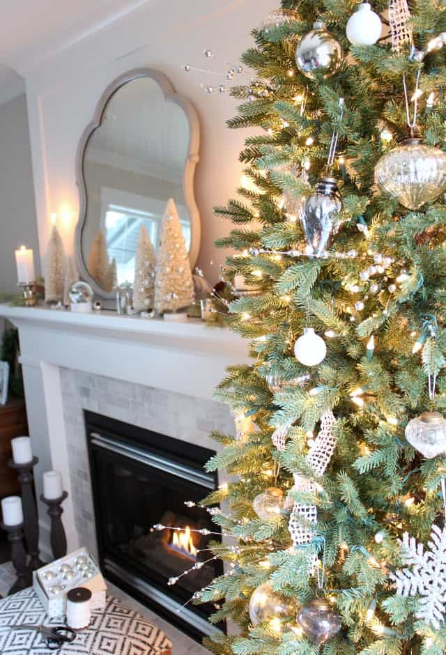 Mantel Decorations for Christmas - a pretty gold and white decorated fireplace with a christmas tree next to it.