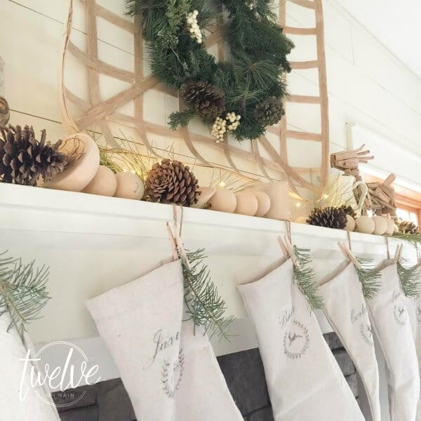 mantel decorations for christmas, neutral christmas decorations with some touches of nature, pine branches and pine cones