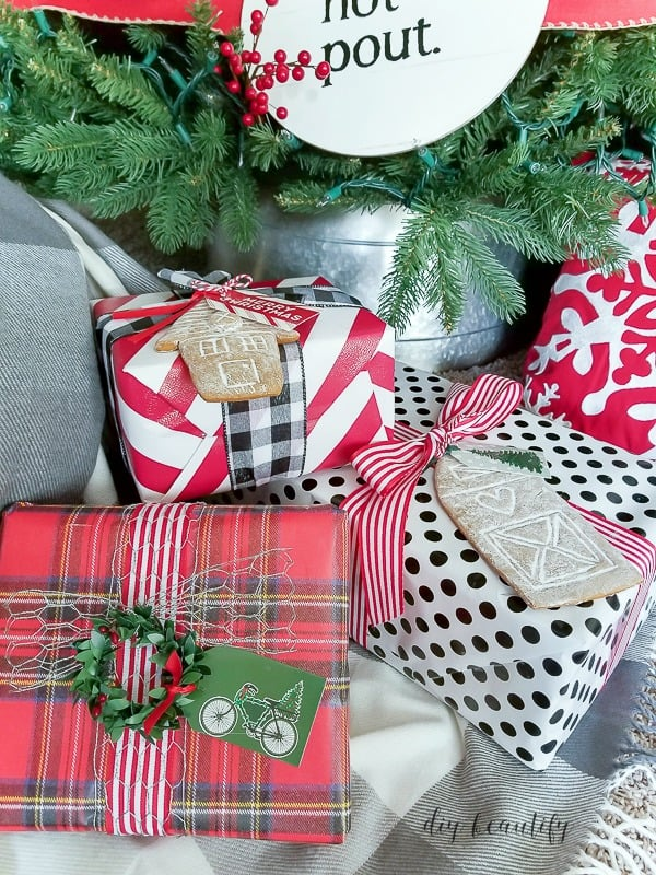 diy gift wrap ideas, how to coordinate all your packages even thought there are different papers with using a coordinating color