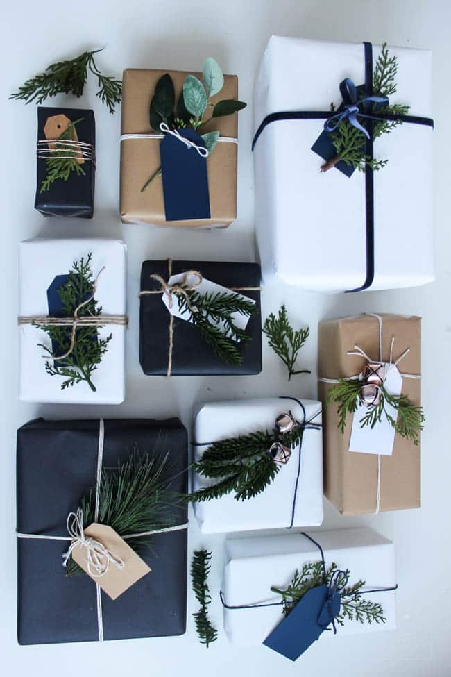 diy gift wrap ideas using solid color paper and sprigs of pine