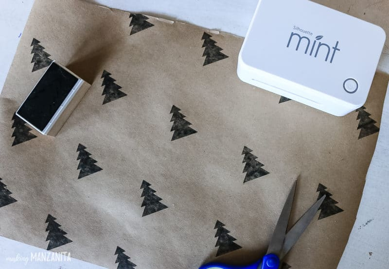 diy gift wrap ideas using a christmas tree stay and brown craft paper
