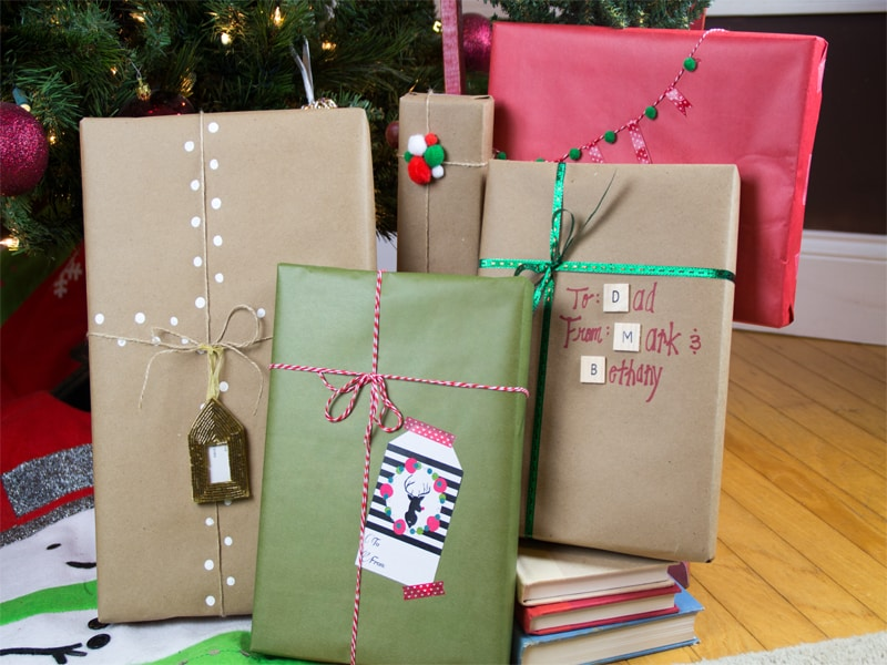 diy gift wrap ideas using craft paper and string, twine, and pom moms