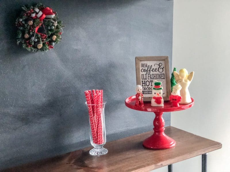Cake stand with Christmas Kitchen Decorations, paper straws and my Christmas Buckeye wreath.