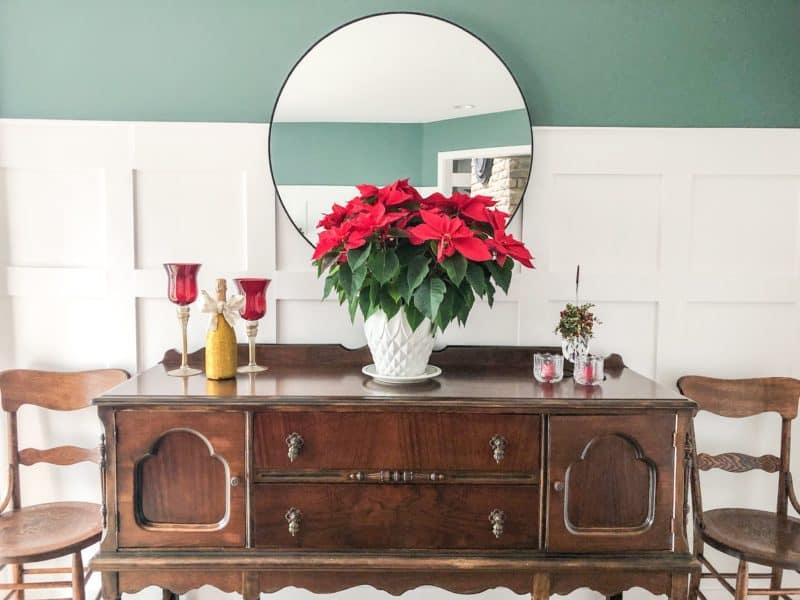 A view of the buffet with a poinsettia, and my gift from my daughter of a champagne bottle that she glittered up.