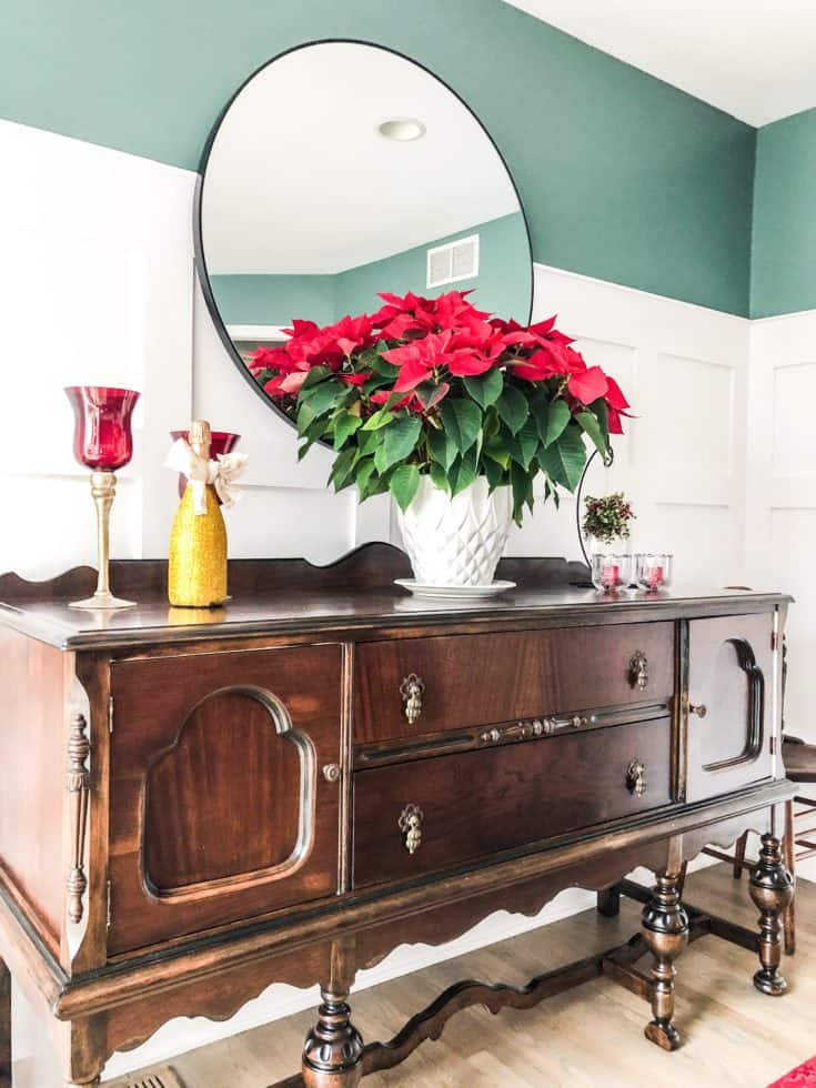 A view of the buffet with the most gorgeous poinsettia on it.