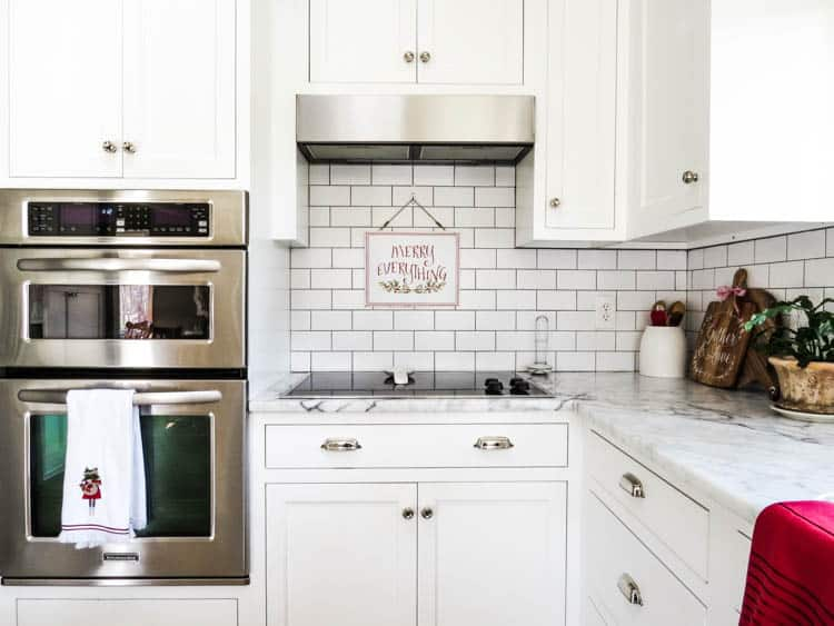 View of ovens, stove and merry everything sign.