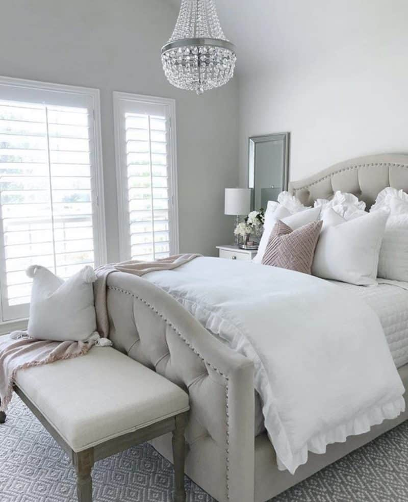 tufted bed with white bedding and lots of pillows to dive into.